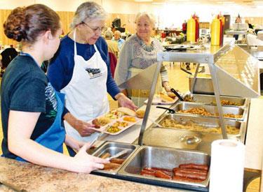 women working in cafeteria